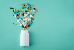 Various medications and vitamins, a pill bottle. Pastel background, place to insert your text. Health and pharmacy.