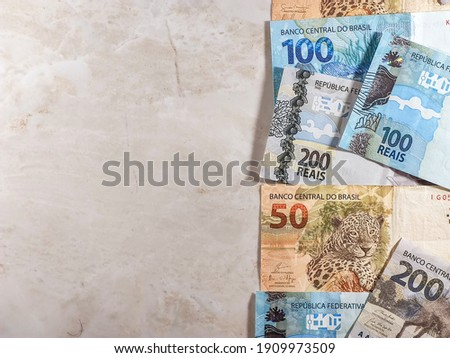 various money notes of 50 reais 100 reais and 200 reais from brazil on a white background. space for text. money from brazil. earn money. Real, Currency, Money, Dinheiro, Reais, Brasil.