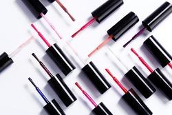 Various nail polish brushes isolated on white background