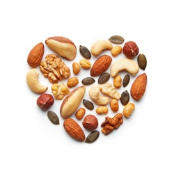 Various nuts arranged in a heart shape. Almond, peanut, brazil nut, pumpkin seed, sunflower seed, cashew, hazelnut, walnut assortment. Healthy lifestyle concept. Top view