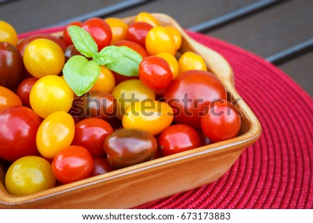 Various of colorful cherry tomatoes in a ceramic bowl. Healthy eating or vegetarian concept. #673173883