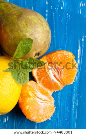 Various of fresh fruits on blue wooden table