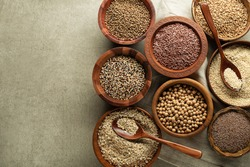 Various of healthy seeds and cereals - sesame, flax seed, chia seeds, soybean, buckwheat and oats. Copy space.