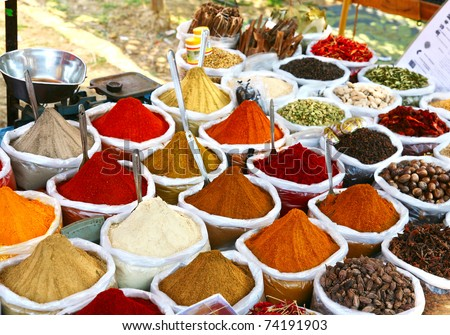 Various of Indian colored powder spices on the Anjuna flea market in India, Goa.