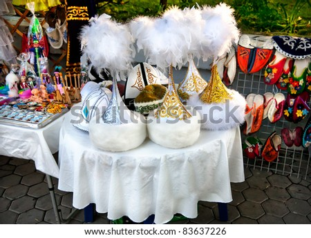 Various of Kazakh ethnic hats and shoes with ornaments in market in Kok-tobe park, Almaty, Kazakhstan