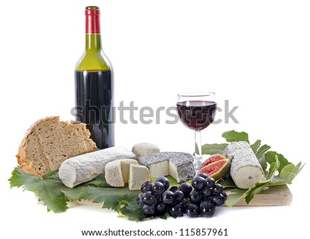 various of local specialty goat cheese, fruits and wine in front of white background