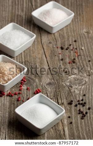 Various of salt and pepper on old wooden table