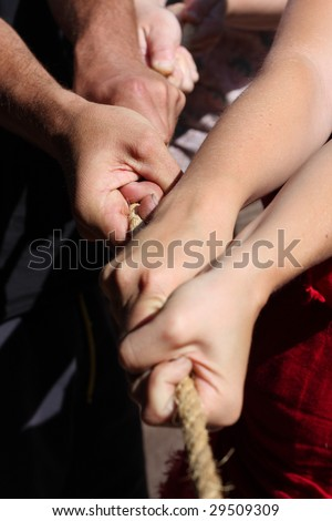 Various people are pulling together at a rope