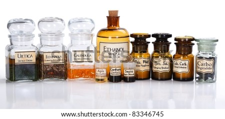 Various pharmacy bottles of homeopathic medicine on white background