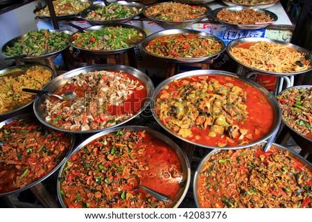 Various platters of Thai Food on a Street Market stall in Bangkok, Thailand.Image by Kevin Hellon.