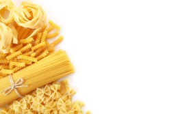 Various raw italian pasta on white background. Top view. Copy space.