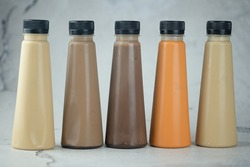 Various refreshing coffee and milk tea drinks in plastic bottle. Close up