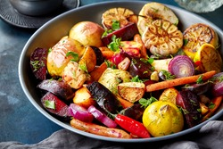 Various roasted fruits and vegetables on gray plate
