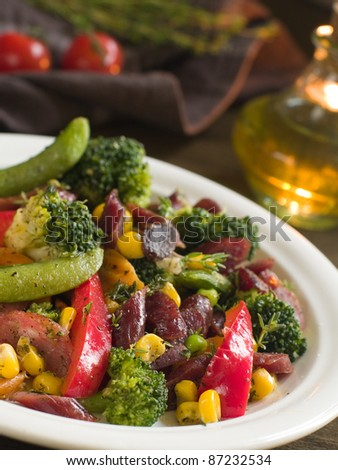 Various roasted vegetable salad with sausage, selective focus