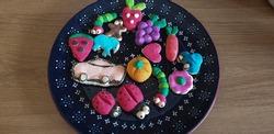 various salt ceramics made for children, small ceramics on ceramic plates