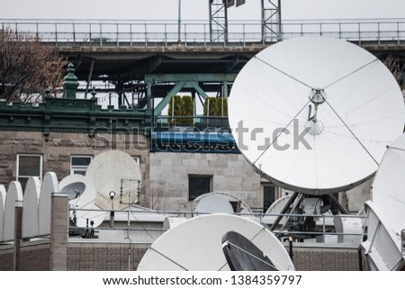 Various satellite dishes and emitters in the technical hub of a media television and radio broadcaster in the suburbs of Montreal, Quebec, Canada