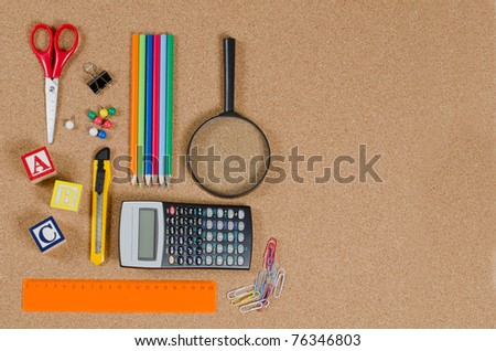 Various school accessories on ñorkboard