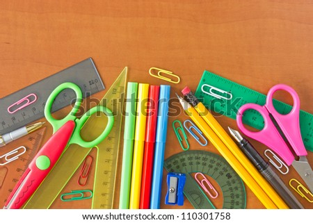 various school supplies on the wooden table
