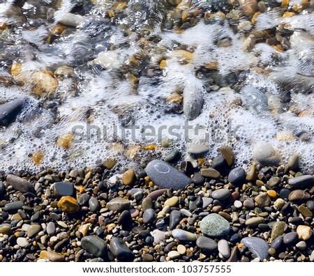 Various sea pebbles and water on the coastline