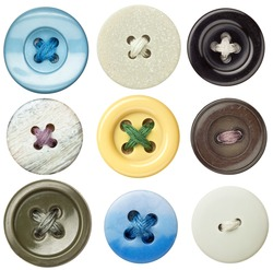 Various sewing buttons with a thread.