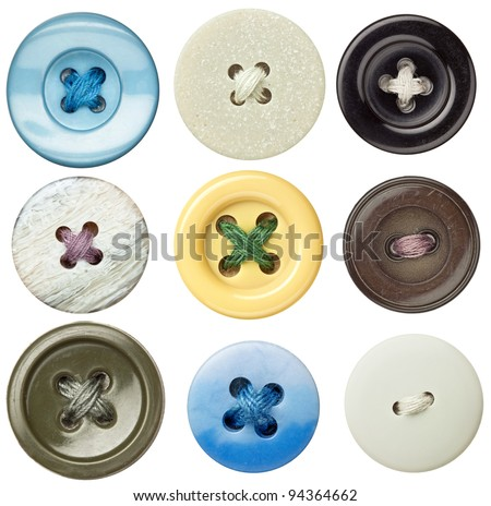Various sewing buttons with a thread. #94364662