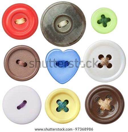 Various sewing buttons with a thread. #97368986