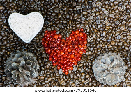 Various shapes made of coffee and whole grains. Brown coffee beans with red heart shape and heart shape of rice. #795011548