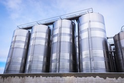 Various silos and vertical metal food tanks for the food industry.