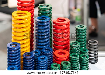 various size and kind of metal coil spring for stamping die or injection mold such as red green blue green color for industrial Сток-фото ©