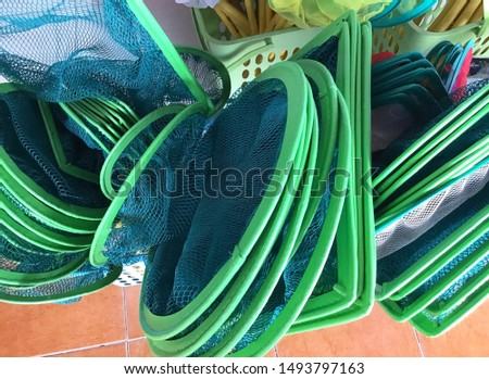 Various Size of Landing Nets, Scoop or Dip Nets Selling in Aquarium Shop. Used For Lifting and Sweeping Up Fish Near Water Surface Out of The Water.