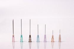 various size of syringe needles isolated on white