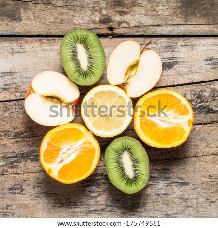 Various Sliced Fruits in Shape of Flower lying on Table. Top View