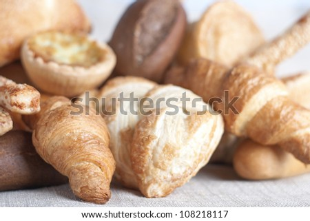 various small baked bread and buns on sacking - stock photo