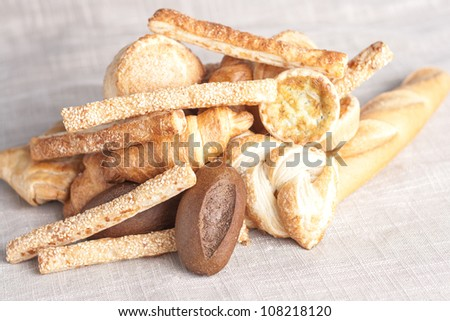 various small baked bread and buns on sacking