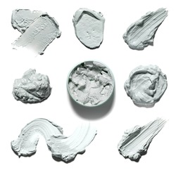 Various smear of facial mud on a white background. Texture of clay mask isolated on white