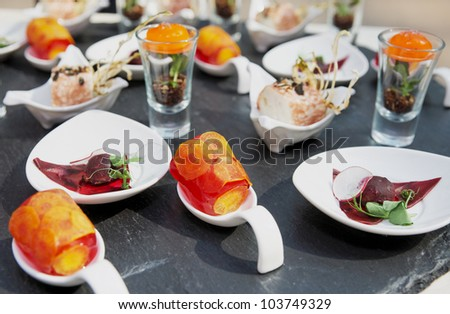 Various snacks on a banquet table - stock photo