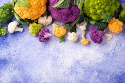 Various sort of cauliflower. Purple, yellow, white and green color cabbages. Broccoli and Romanesco