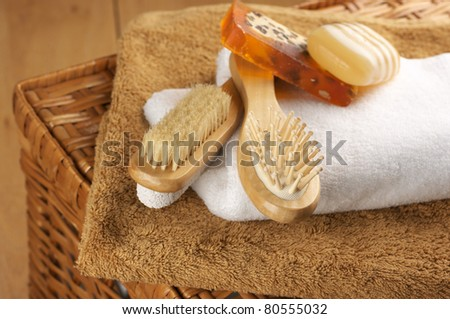 Various SPA accessories on wicker basket.