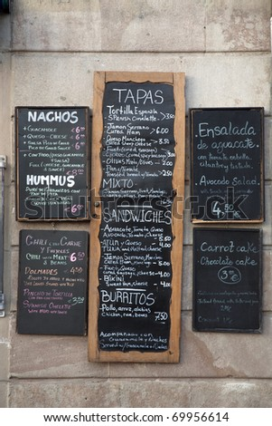 Various Spanish Menus on a Wall in Spain