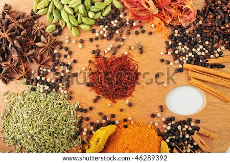 Various Spices are located on a wooden palette