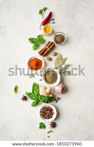 Various Spices, Herbs and Condiments on white stone table, top view, copy space. Healthy cooking, indian food background. Stockfoto ©