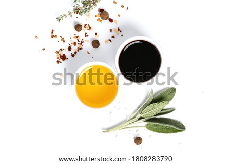 Various spices, herbs, olive oil and balsamic vinegar on a white background top view. Free space for text. Food background, ingredients for cooking. Foto stock ©