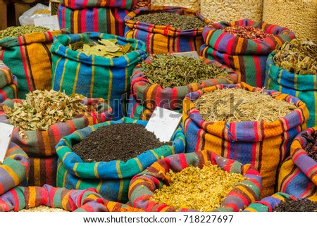 Various spices in colorful sacks on sale in the market, in Acre (Akko), Israel.