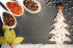 Various Spices on Christmas background.