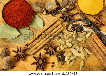Various spices on wooden board - vintage style background