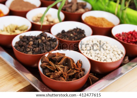 Various spices selection. Indian spices such as star anise, pepper, cumin, cloves, cinnamon, cardamom, in different bowls at the fair or bazaar. Tasty, spices and healthy food.