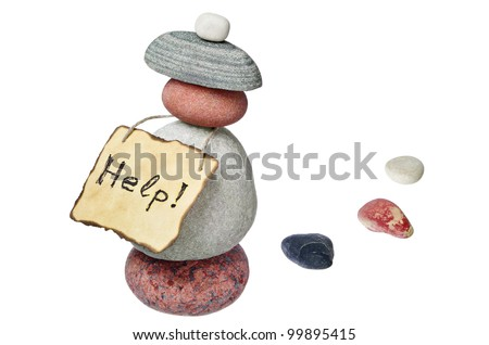 Various stones and old note paper isolated on white