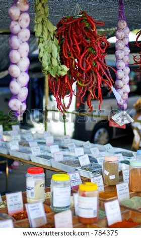 Various tapas and spices for sale in plastic tubs at a Spanish market on the Costa del Sol - stock photo