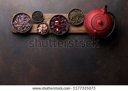 Various tea and teapot. Black, green and red tea. Top view with space for your text