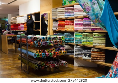 various textiles for sale in fabric shop